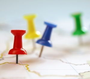 Points on a map indicated with colorful thumbtacks