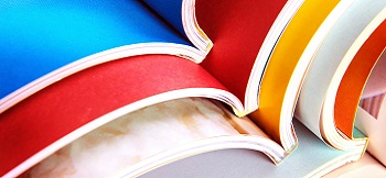Image of a stack of colourful reports