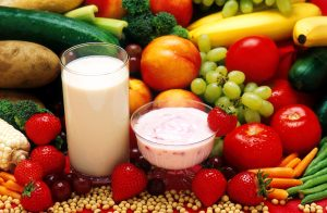 A picture of fresh fruit and vegetables, milk and yoghurt